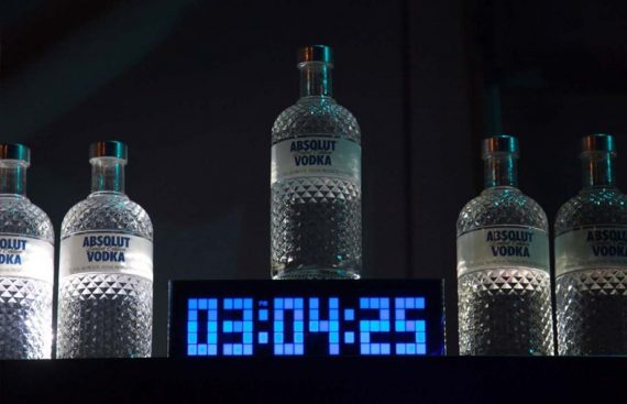 Absolut vodka bottle and clock